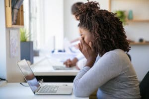 young lady stressed at laptop