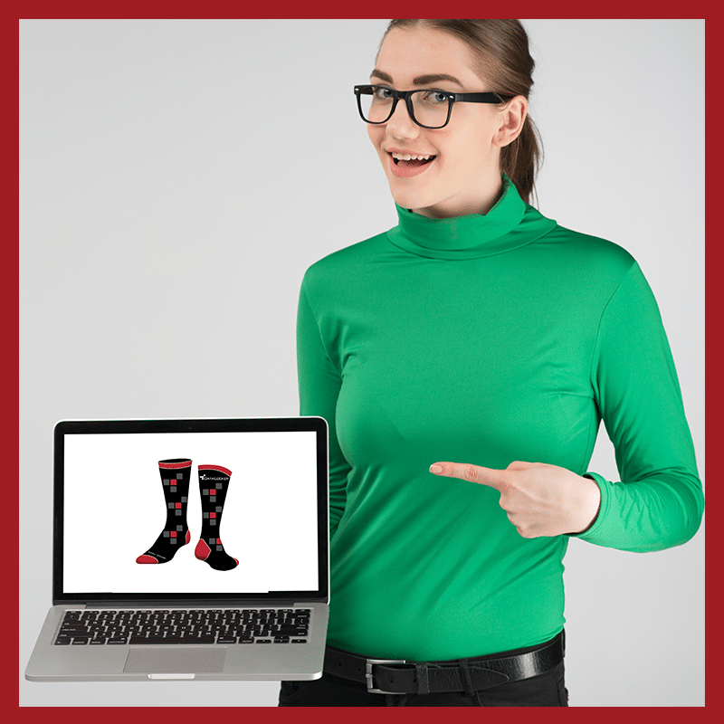 girl pointing to sock mockup on laptop screen