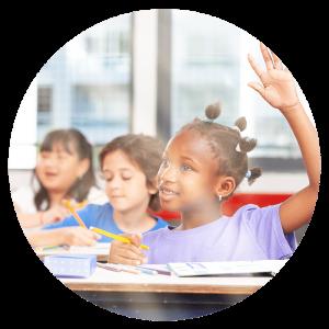 girl raising her hand in classroom