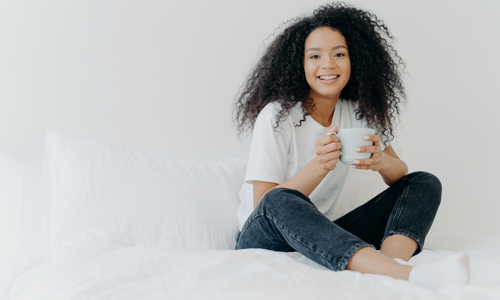 woman drinking tea and smiling